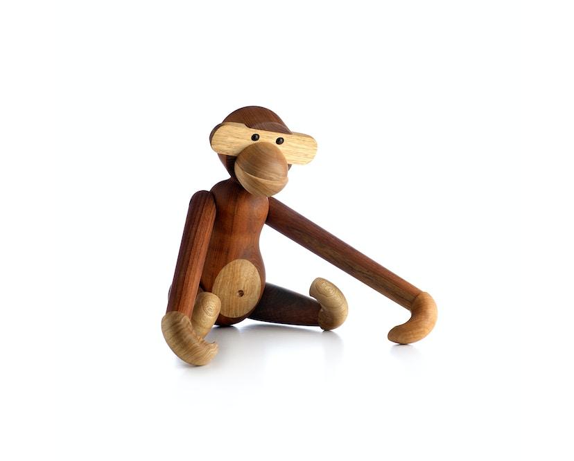 Figurine en bois en forme de signe